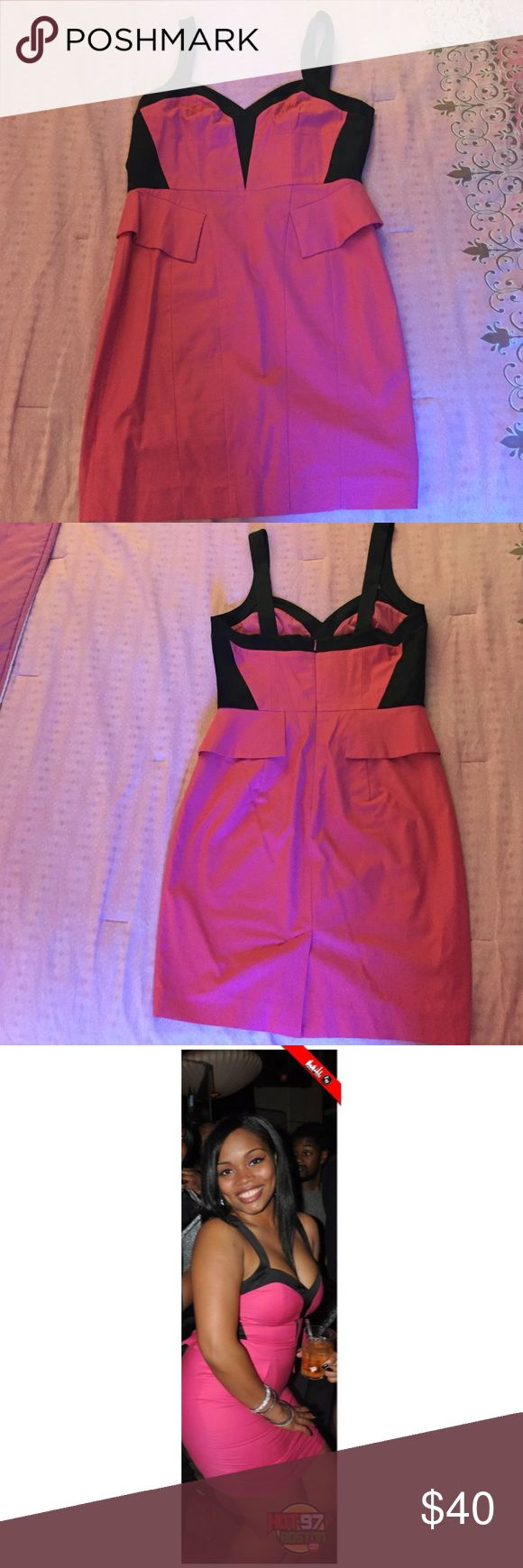 Bebe Black and Pink Pencil Dress Bebe Black and Pink Pencil Dress with Peplum Detail. Size 10. Worn Once. Excellent Condition! bebe Dresses Midi