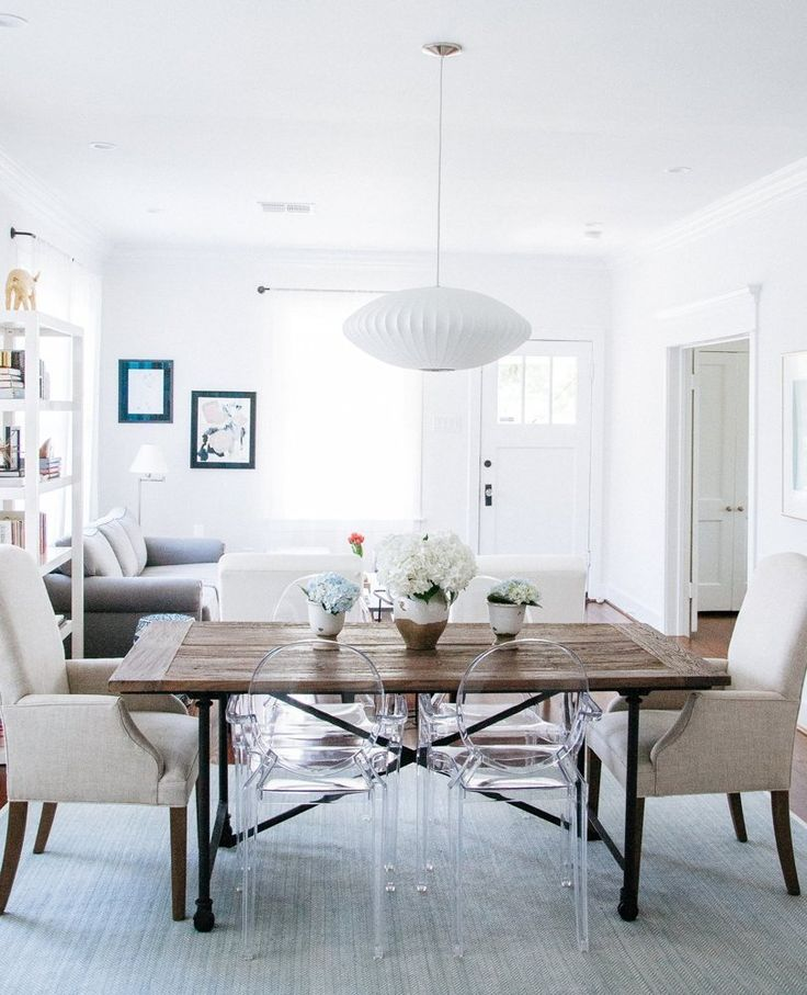 clean white dining room ghost chairs
