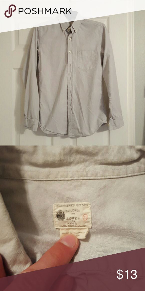 J. Crew Oxford Shirt Sunwashed Oxford Shirt. Tailored fit. Decent used condition. It has a slightly wrinkled look even after ironing which is common for Oxford shirts. J. Crew Shirts Casual Button Down Shirts