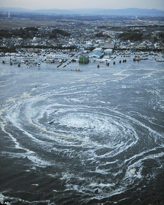 A whirlpool caused by currents from a tsunami near the port of Oarai after Japan was struck by a strong earthquake off its north-eastern coast today. The disaster comes two days after online warnings that the movement of the moon will trigger tidal waves, volcanic eruptions and earthquakes  Read more: http://www.dailymail.co.uk/sciencetech/article-1365225/Japan-earthquake-tsunami-Did-supermoon-cause-todays-natural-disaster.html#ixzz4ClMDvHju  Follow us: @MailOnline on Twitter | DailyMail...