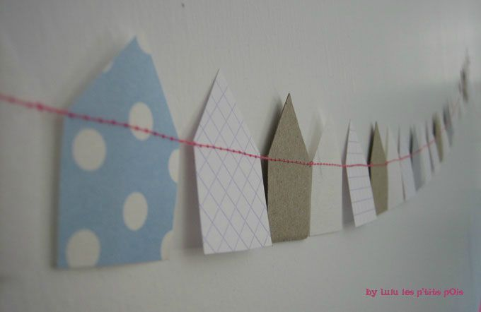 Paper houses garland by Lulu les p'tits pois (would be cute for a welcome home banner or a housewarming party)