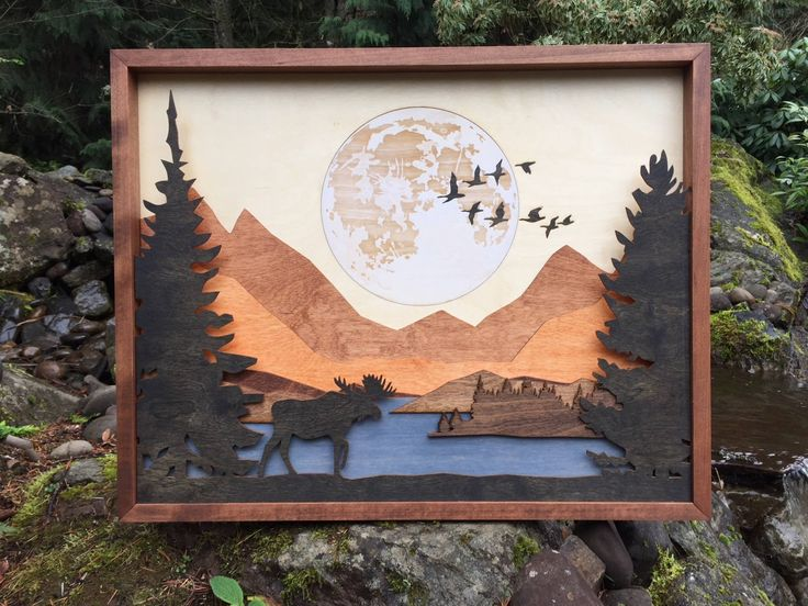 """Go Big or Go Home - we are now presenting new images on a larger scale!  This beautiful 9 layer etched and inlaid Moose in Forest measures 25""""x20""""x1.5"""" and will add the beauty of the wilderness to your home.  Our attention to detail assures a quality handcrafted work."""