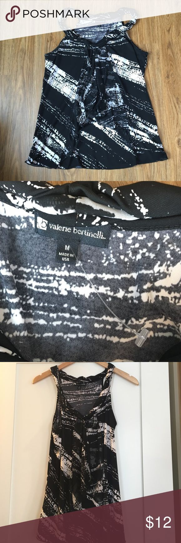 NWOT Blouse New without tags, Black and white sleeveless blouse. Tops