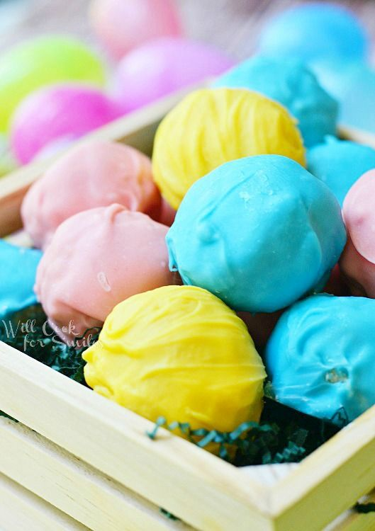 These are Oreo Truffles made with golden marshmallow crispy Oreos and marshmallow fluff, and then coated in colorful candy coating.