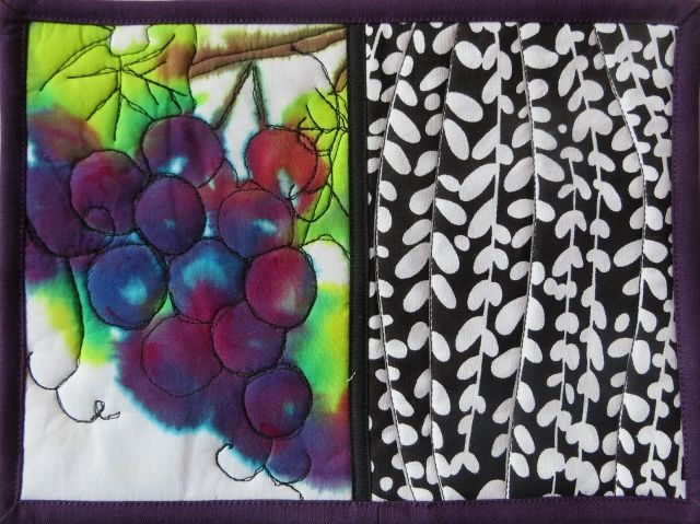 Grapes painted onto cotton.