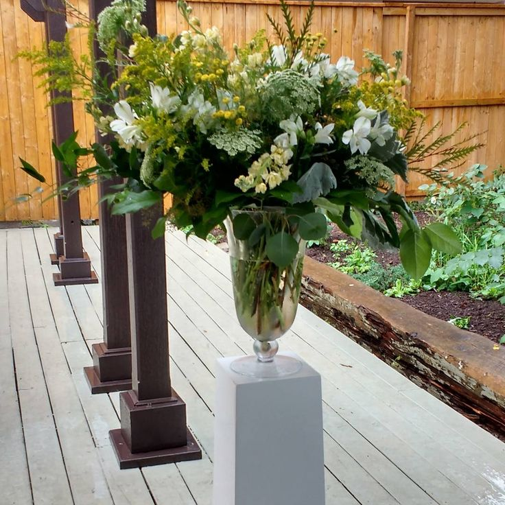 ceremony flowers at Berkley event space, flowers by Periwinkle Flowers