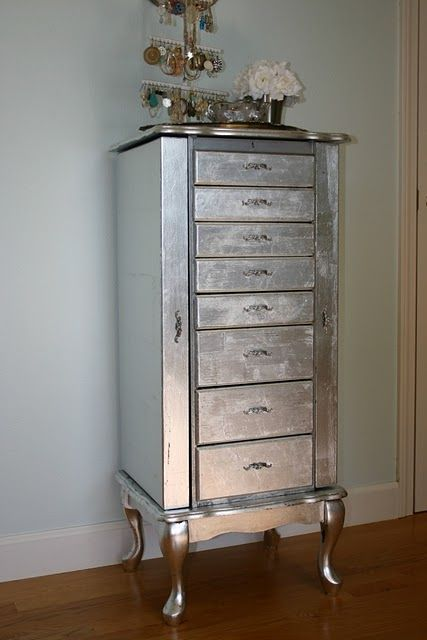 DIY Directions to silver leaf a cabinet -- gorgeous! I LOVE this. You have to search a bit for the directions but I was interested as I have the exact jewelry cabinet. This project looks a little tedious but I'm thinking about it........