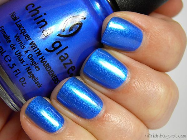 "China Glaze's ""Frostbite"" - I love this because it goes on super shimmery and is a totally eye-popping color. Looks good on dark, tan, or pale skin. Versatile!"