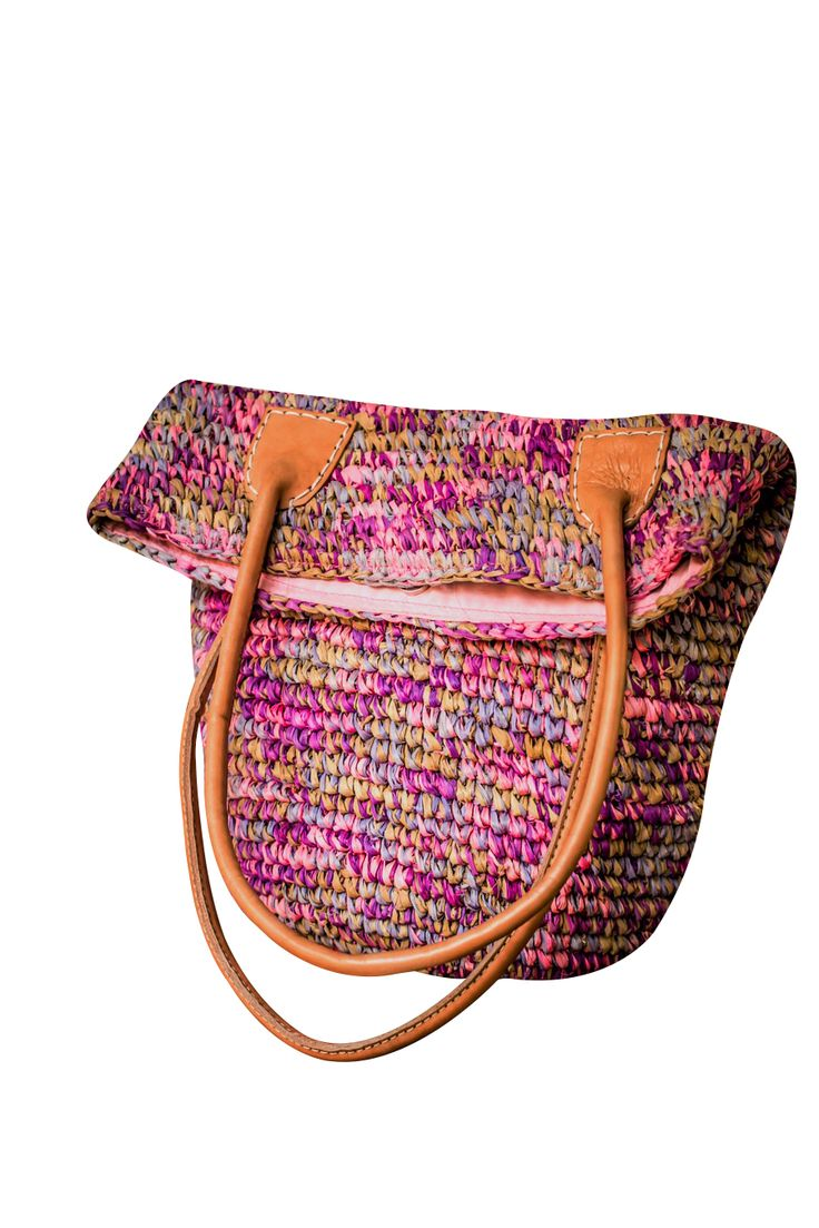Pink palm leaf bag with leather straps.