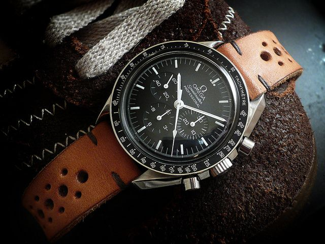 Omega Speedmaster Pro 'Moonwatch' with light brown 'racing' strap.