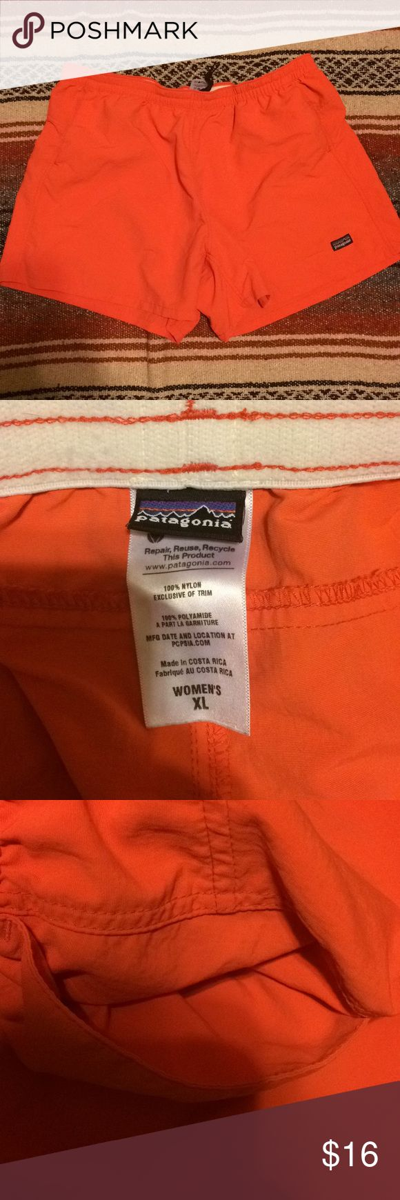 Coral Patagonia Nylon Shorts - XL Coral pink Patagonia nylon shorts with pocket. Size women's XL. Everything is in perfect condition minus a few small pen stains on the back inside of the right leg. They are tiny and hard to spot when not up close (pictured) but they are present and reflected in the price. Patagonia Shorts