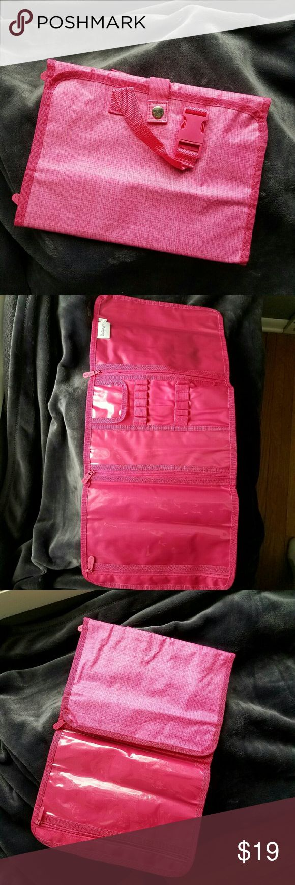 Thirty-one Timeless Beauty Bag *New In Package, Never Used*  This versatile organizing bag can be used everyday, for travel, or both!  Perfect for organizing make-up, jewelry, hair accessories, and much more!  100% Polyester   Approx. 11? x 8? closed  Approx 11? x 24? open   ~Snap Closure  ~ Carry and hanging handle  ~ 3 clear PVC zipper pouches  ~12 elastic loops to hold brushes Thirty-one  Bags Cosmetic Bags & Cases