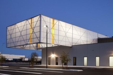 Westralia Airports Corporation (WAC) - Perth Airport estate. A dramatic 10 metre by 15 metre cantilevered structure with translucent cladding which is backlit to form a dramatic 'lantern' effect on the streetscape and to signify the entrance and the street corner location of the site.