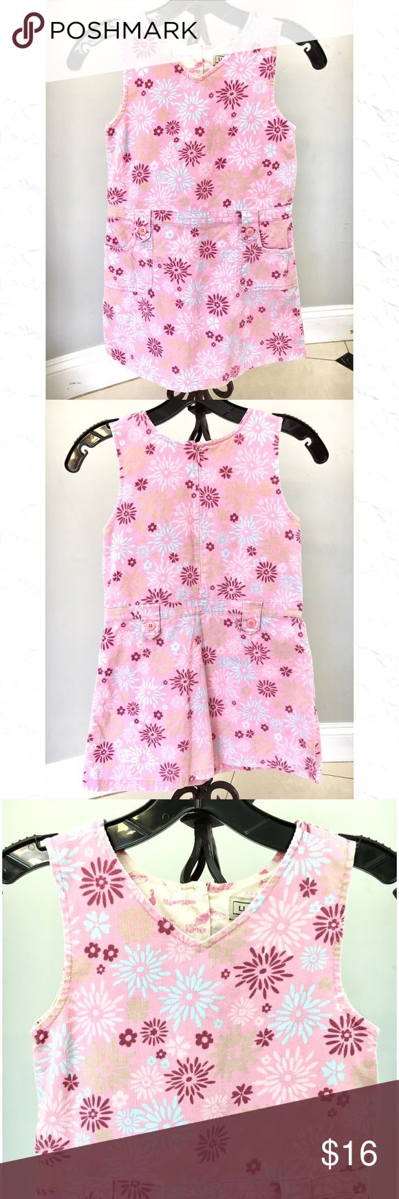 "🎈L.L Bean Girls Pink Flower Print Dress 6X - 7 Spring or Summer Girl L.L. Bean Flower Print Dress Size 6X-7.  Front pockets.  V- neck.  100% Cotton.  Corduroy type fabric.  Back Zipper.  25"" from Shoulder to Hem.  13"" across armpit to armpit.   13 1/2"" across at the waist. L.L. Bean Dresses Casual"