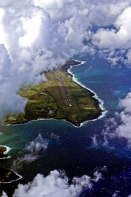 A break in the clouds reveal Lihue airport in Kauai, Hawaii.
