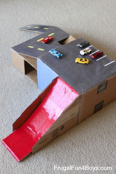 Here's a fun cardboard box toy to make – a Hot Wheels parking garage with ramps! The great part about cardboard box projects is that the materials are free, and you can toss it in the recycling bin when the kids are done with it.  (We do NOT save all the projects we make!) Daddy …