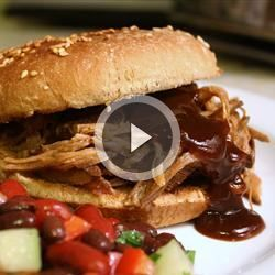 Slow Cooker Texas Pulled Pork | Texas-style pulled pork simmers in a tangy sauce.