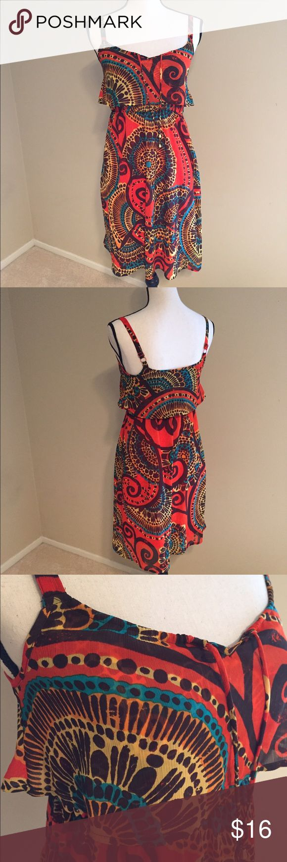 Madison orange sheer gauzy dress petite small Adorable dress perfect for the summer. In excellent condition! 100% polyester. The top is not lined but the bottom half is. Chest is 14.5 inches and the length is 35.5 inches Madison Dresses Mini