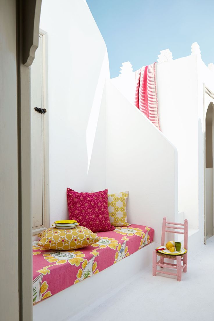 pair brightly coloured fabrics against a crisp white background.