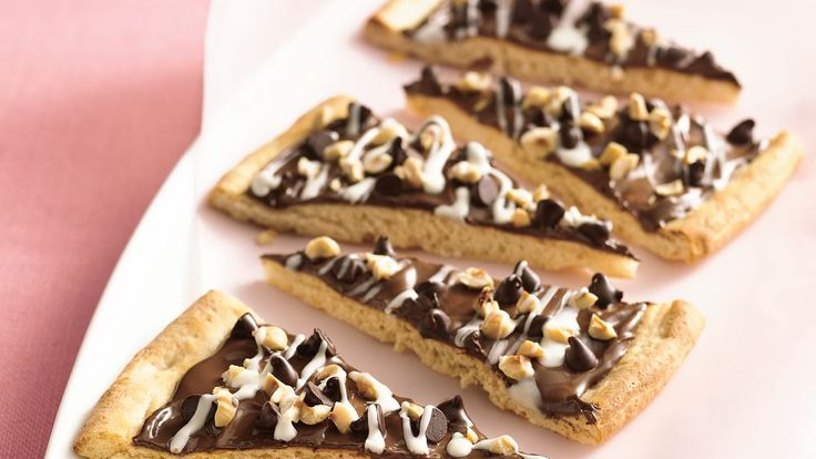 Pizza parlors move over--this pizza takes the cake!  Topped with chocolate-hazelnut spread and sprinkled with three different flavored chips, this sweet treat will be a cookie plate hit.