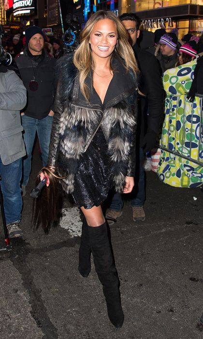 Model Chrissy Teigen stepped out for New Year's Eve in Times Square in a leather jacket, two-toned faux-fur vest and a sequinned frock worthy of the iconic ball that dropped at midnight. Photo: © Getty Images