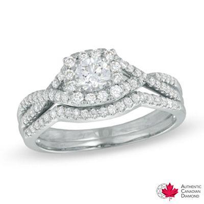 0.70 CT. T.W. Certified Canadian Diamond Twist Shank Bridal Set in 14K White Gold (H-I/I1)