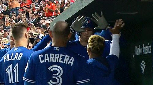 Marcus Stroman hugs Michael Saunders after he hits his third home run of the night versus the Orioles
