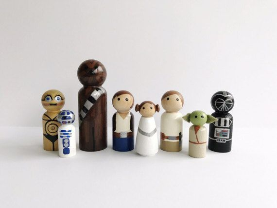 This listing is for a set of 8 Star Wars themed peg dolls Hand painted peg dolls. Chewbacca- 3 1/2 tall Yoda & R2D2- 1 11/16 tall Leia- 2 tall Luke, Han, Darth Vader, and C3PO- 2 3/8 tall Yoda ears are made out of felt that has been glued on and sprayed with fabric stiffener. Non toxic paint and sealer used for safe play. Paint color may vary.