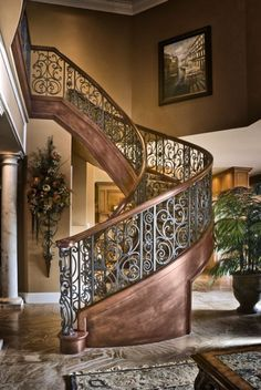 Elegant iron staircase that will capture your guests as you walk down to greet them