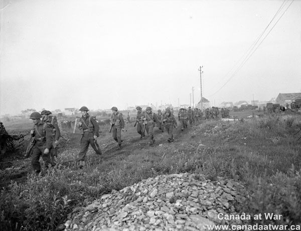 Infantry on the move at dawn. 25 July 1944, South of Vaucelles.