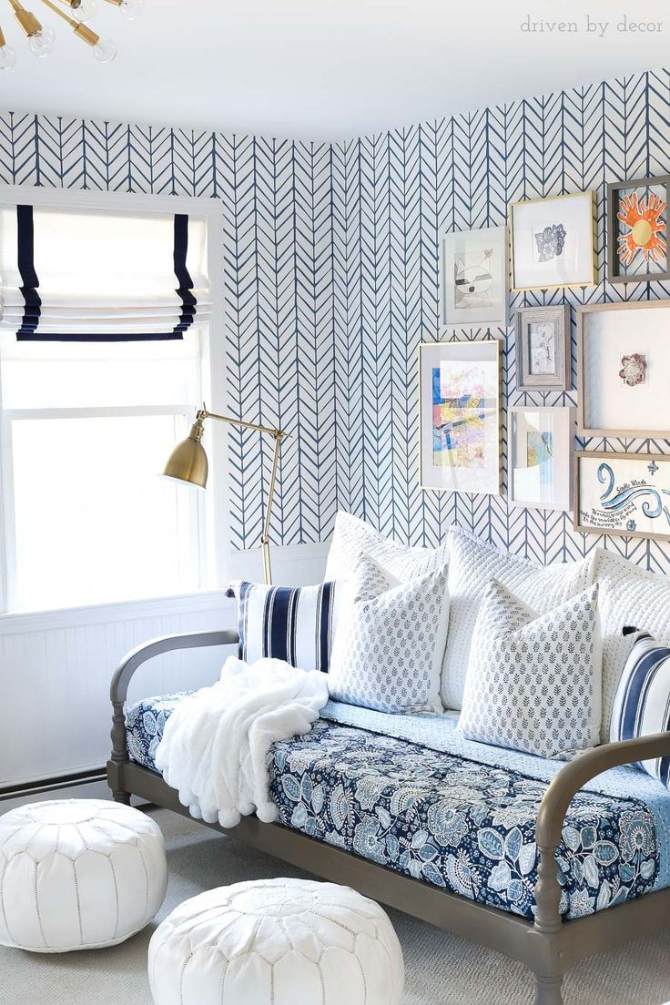 Blue and white bonus room area with daybed, blue floral quilt, blue and  white
