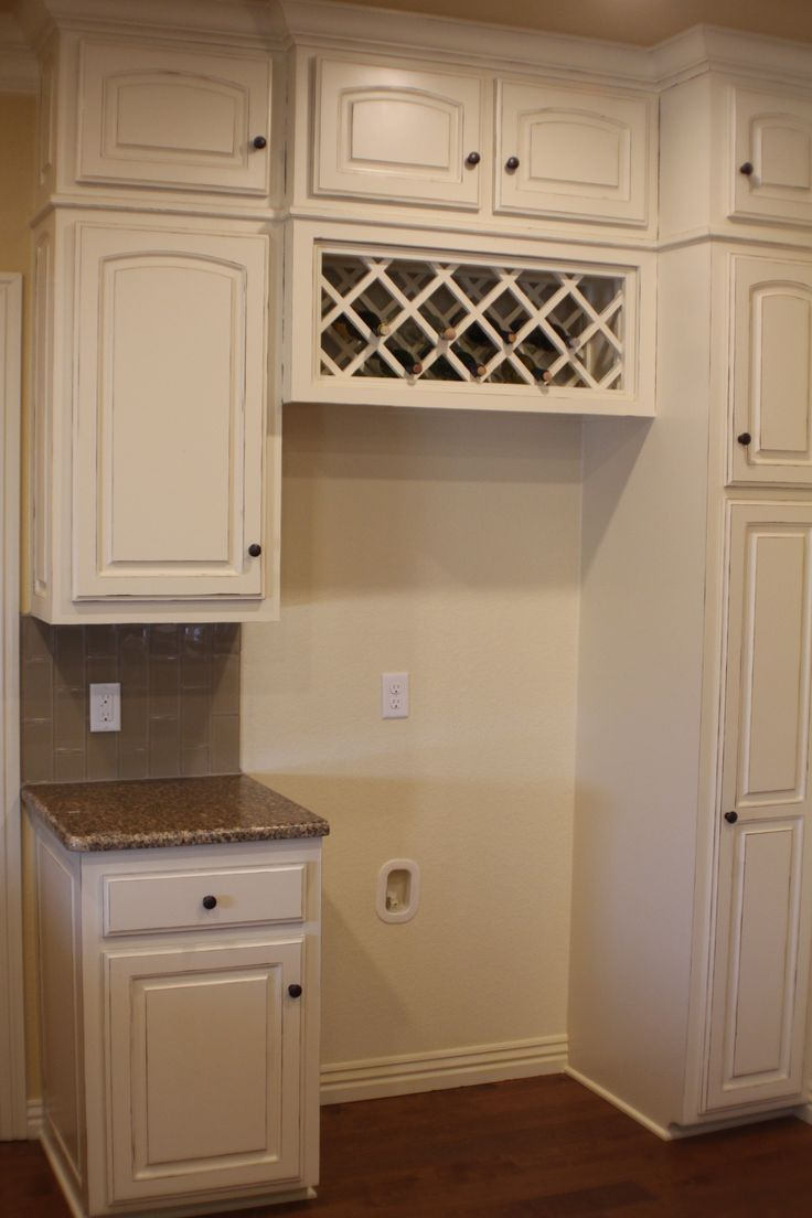 built in wine rack above fridge...still on the fence about this one, but maybe