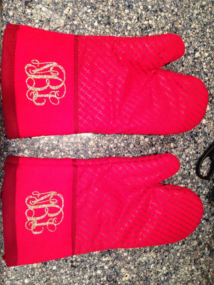 Monogrammed oven mitts - use heat transfer materials and a heat press to make personalized shower gifts.