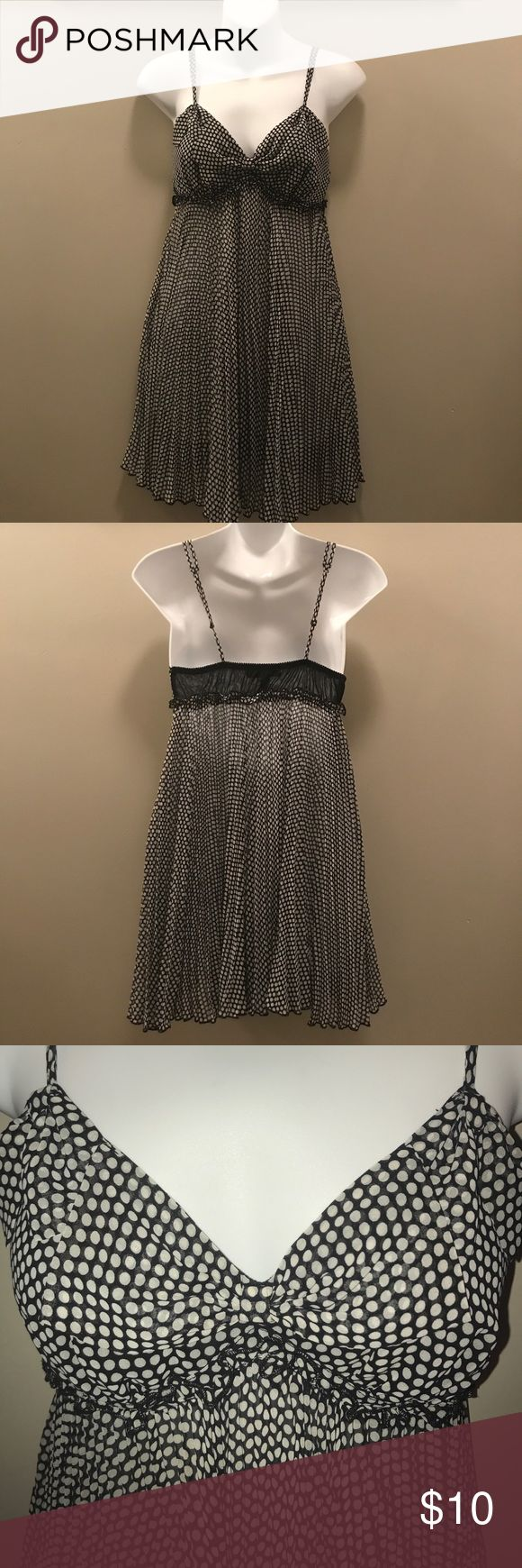 Betsey Johnson Polka Dot Nightie This Betsey Johnson Intimates Polka Dot Nightie is in good used condition. It has a bow detail on the front with a double strap detail. This has a ruffle detail along the bra line and a pleated style skirt. This is a size small. Betsey Johnson Intimates & Sleepwear Chemises & Slips