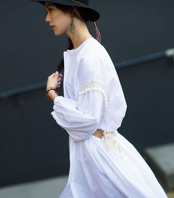 This cotton white dress with pom-poms is perfect for summer // Photo: Adam Katz Sinding of Le 21ème