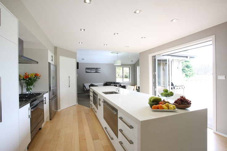 Crisp white and stainless steel kitchen.