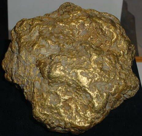 The Alaska Centennial Nugget - 294.10 Troy Ounces, The largest gold nugget ever found in Alaska. It was found near Ruby, Alaska in 1998 by a miner as he operated his bulldozer. The nugget rolled off the pile of dirt ahead of the bulldozer blade. This nugget was sold  the current location is unknown ©Marshall Ronne, Jr.