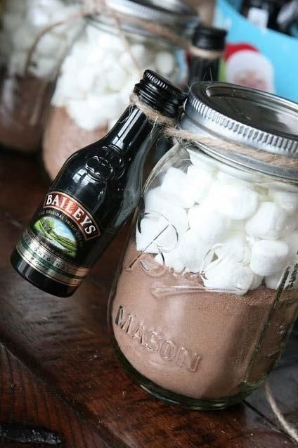 A cool DIY gift.. A jar of hot chocolate powder, marshmallows, and Bailey's. Inexpensive and fun! Awesome gift for a student!  Lauren's note: Finally did this as a christmas gift for a few of my friends! Was a cheap gift but easy to do. I tried to use ribbon to tie the alcohol to it but it did not work without tape.. I'm guessing string like in the picture would work the best! I also put the mini marshmallows in a ziploc inside the jar for easier access to the powder. All in all a gr