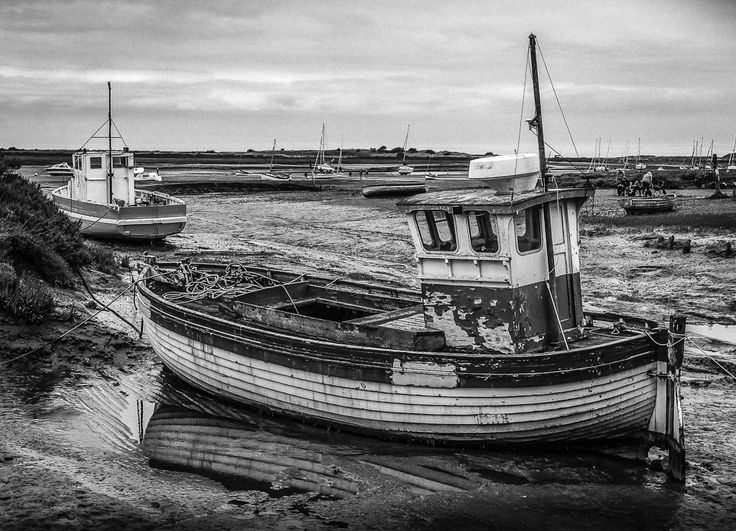 Boats waiting for the tide at Brancaster Staithe on the North Norfolk coast. Image taken and processed by Milly M