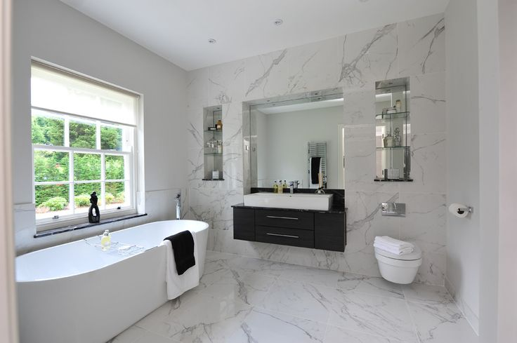 Minoli Tiles - Evolution Marvel - Polished white marble look porcelain tile to transform your bathroom into a luxurious space has to be Minoli Marvel Calacatta Extra Lappato. Look at this bathroom from one of our projects, Sunningdale. https://www.minoli.co.uk/tiles/marvel-calacatta-extra-2/ - #Minoli #minolitiles #porcelain #tile #porcelaintile #tiles #porcelaintiles #marblelook #marbleeffect #Marvel #calacatta #lappato #polished #shiny #bathroomidea #homedecor #interiordesign #halfwall