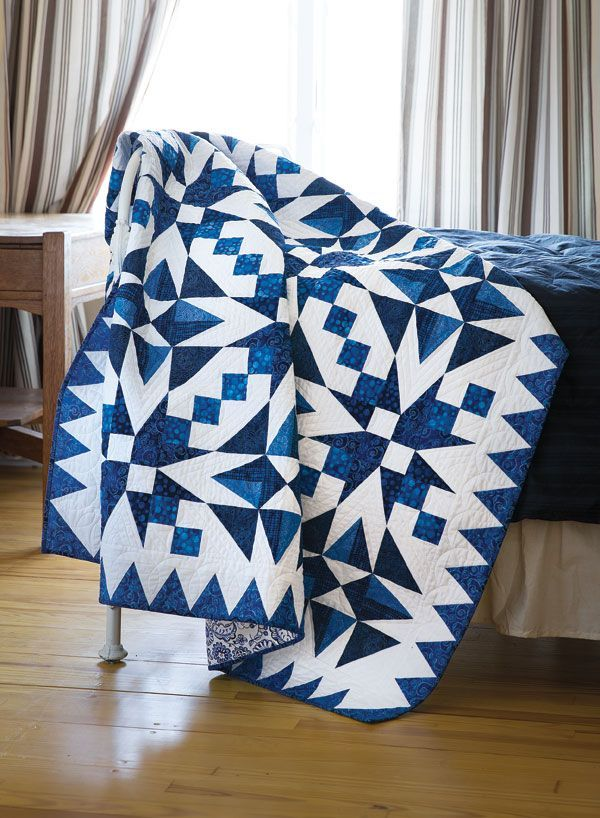 """When it comes to quilting, """"having the blues"""" can be a good thing! Take, for example, Nancy Mahoney's quilt. Using fabrics in a blue-and-white color scheme, she made two simple blocks, resulting in this rhythmic, high-energy design."""