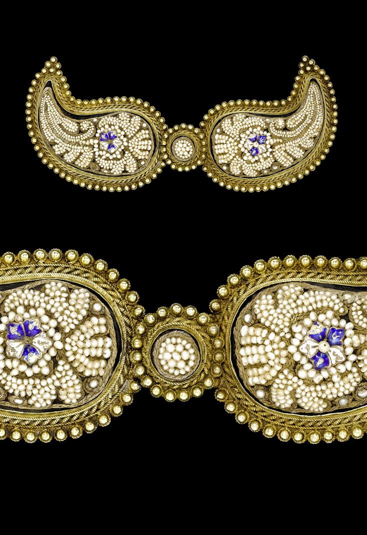 Turkey | Ottoman embroidered seed pearl and silver gilt belt buckle, with side section centres decorated with enamelled flowers | ca. 19th century | Est. 1'000 - 1'500£ ~ (Apr '08)