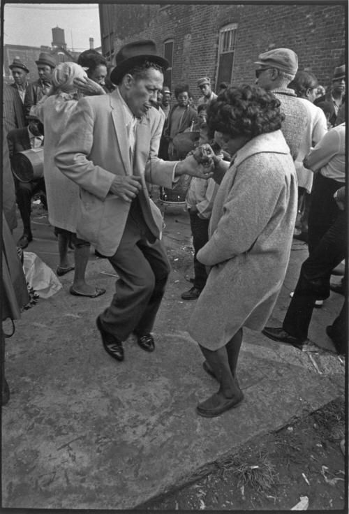 People dancing near Peoria St. between Maxwell St. and 14th St. Undated photograph by James Newberry.