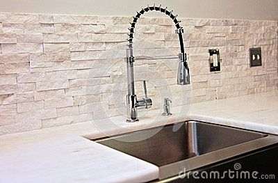 http://thumbs.dreamstime.com/x/modern-kitchen-detail-sink-marble-counter-stacked-stone-back-splash-industrial-spray-faucet-40079728.jpg