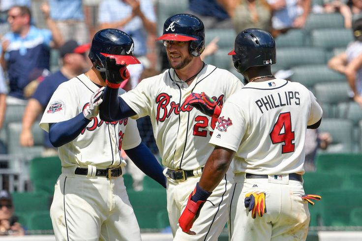 Aug 20, 2017; Atlanta, GA, USA; Atlanta Braves catcher Tyler Flowers (25) shakes hands with right fielder Nick Markakis (22) and third baseman Brandon Phillips (4) after hitting a grand slam home run against the Cincinnati Reds during the fifth inning at SunTrust Park. Mandatory Credit: Dale Zanine-USA TODAY Sports