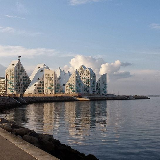 The Iceberg, Aarhus, Denmark JDS Architects, the creators of the harbor-front apartment complex, is the recipient of multiple architectural honors for its functional and smart design: The jagged lines maximize the amount of sunlight, while the interspersed placement provides a view of the ocean from each building.
