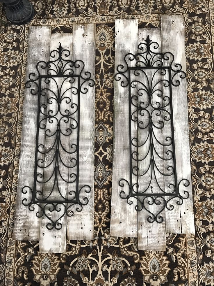 Old pallet wood, a little Chalk Paint, and some wrought iron decorations are what I used to make this rustic wall art.
