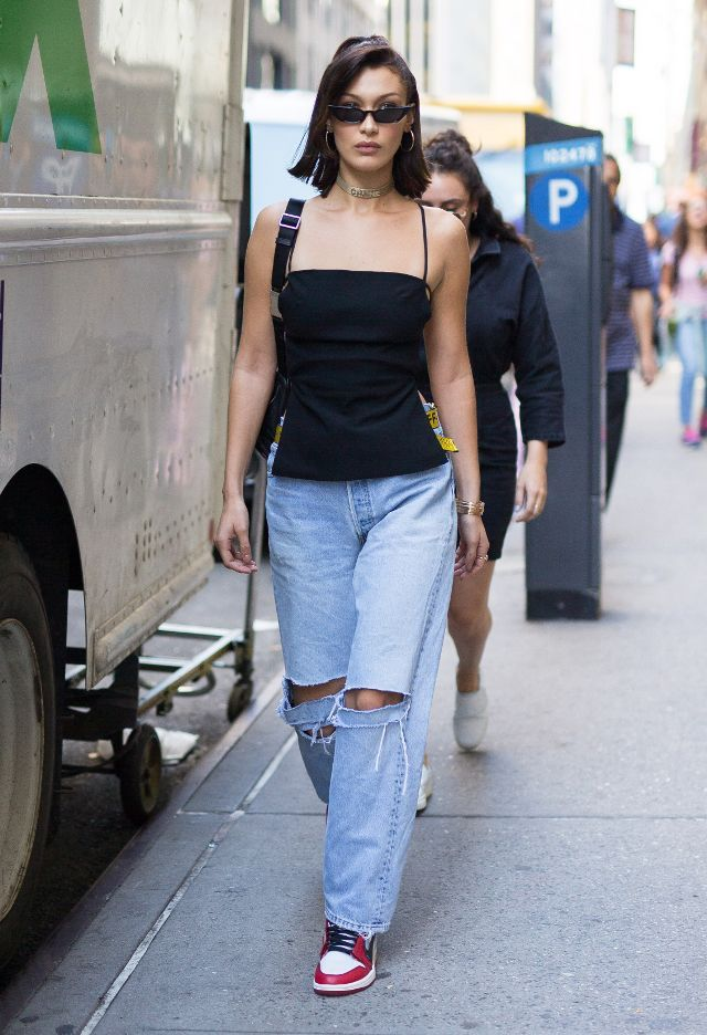 ae4ca5c74a29 On Bella Hadid  Cult Gaia tunic  Danielle Guizio vintage Levi s jeans  Nike  Air Jordan 1 Retro High OG Chicago ( 525)  Poppy Lissiman Le Skinny  Sunglasses ...