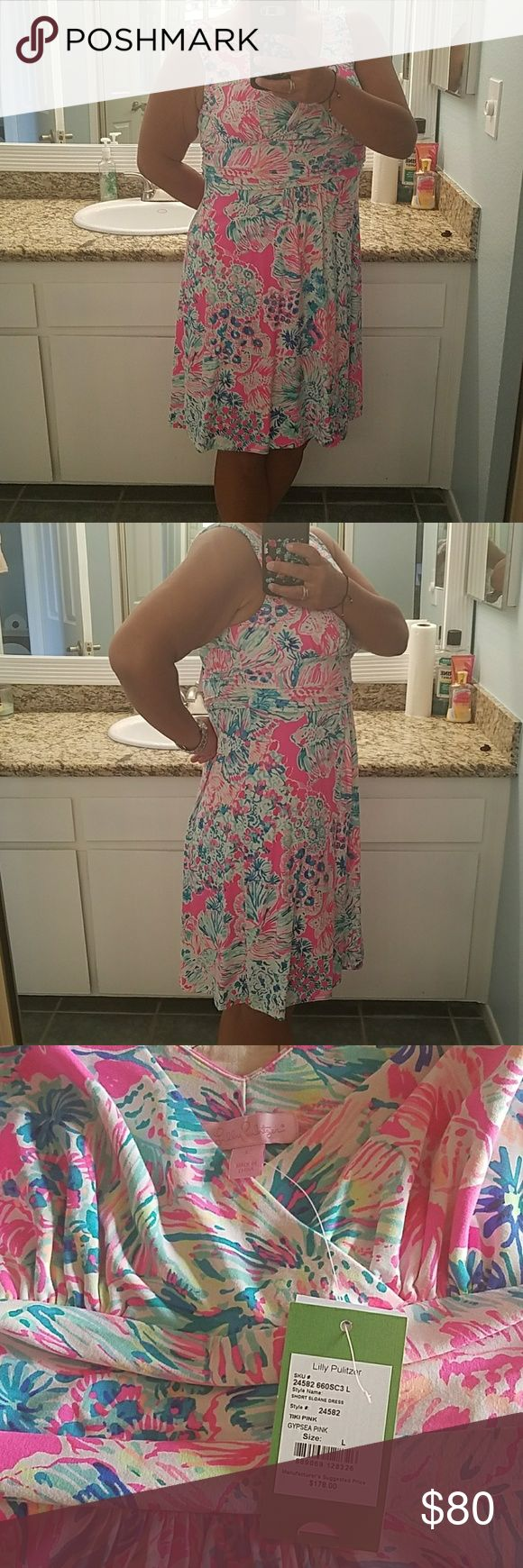 Lilly Pulitzer dress Beautiful summer dress, vibrant colors. Perfect for the beach. 96% rayon and 4% spandex. This is the Tiki Pink dress style # 24585 Lilly Pulitzer Dresses Mini