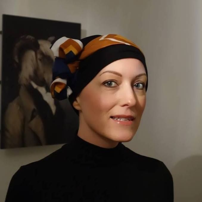 Stylish scarf tying for hair loss - base jersey Kimmy hat with a strong abstract print scarf.  Black turtle neck and your Hepburn chic!